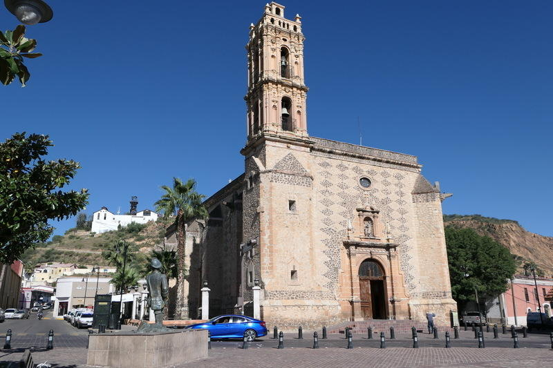 Parral's main church with the mine lurking behind